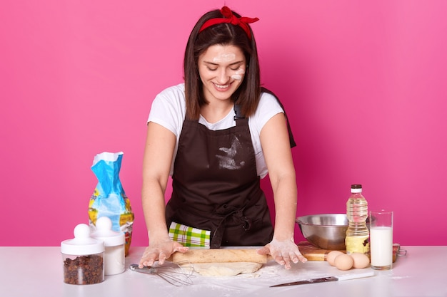 Happy housewife or baker wears kitchen apron dirty with flour, white t shirt Free Photo
