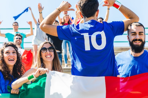 Happy italian fans at stadium for soccer match Premium Photo