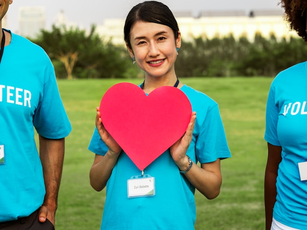 Happy japanese volunteer with a heart Free Photo