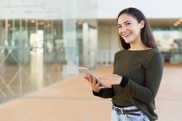 Happy joyful customer getting online on tablet Free Photo