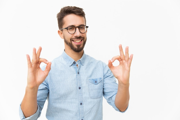 Happy joyful guy showing ok gesture Free Photo