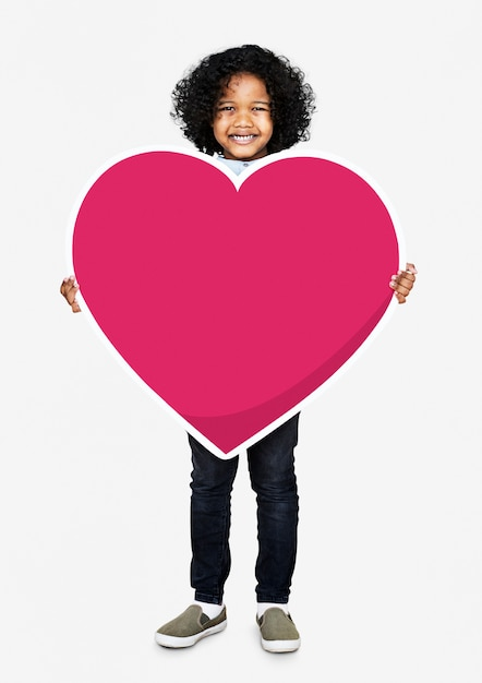 Happy kid holding a heart icon Free Photo