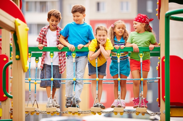 Happy kids playing and laughing on playground Free Photo