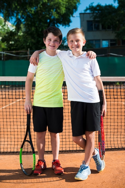Happy kids on the tennis field Free Photo