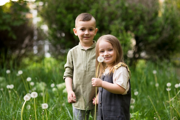 Happy kids together in nature Free Photo
