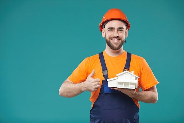 Счастливый рабочий с пустышкой Premium Фотографии