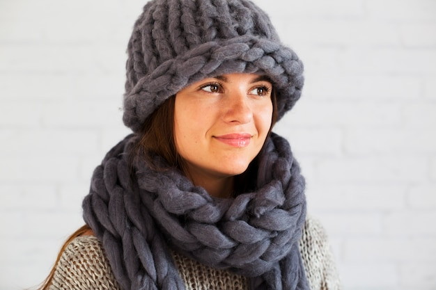 Happy lady in hat and scarf Free Photo