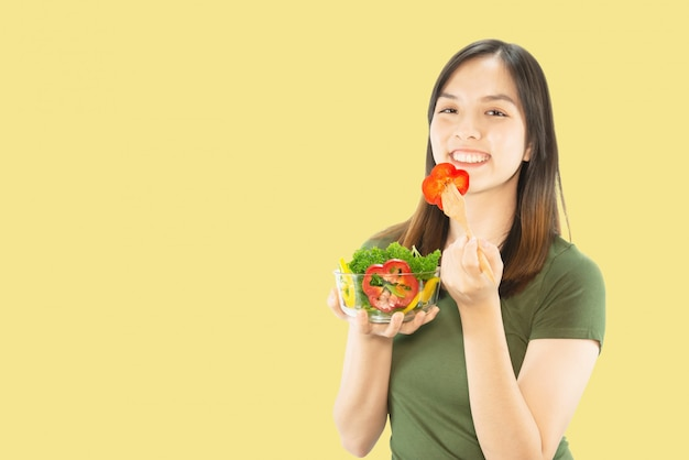 Happy lady holding kitchen stuff over copy space background Free Photo