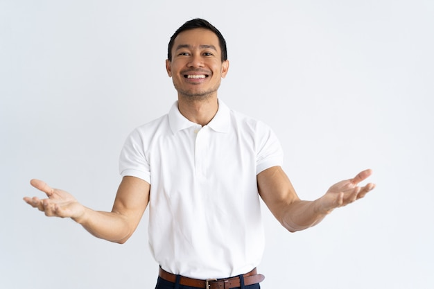 Happy latin guy outstretching hands and ready to hug Free Photo