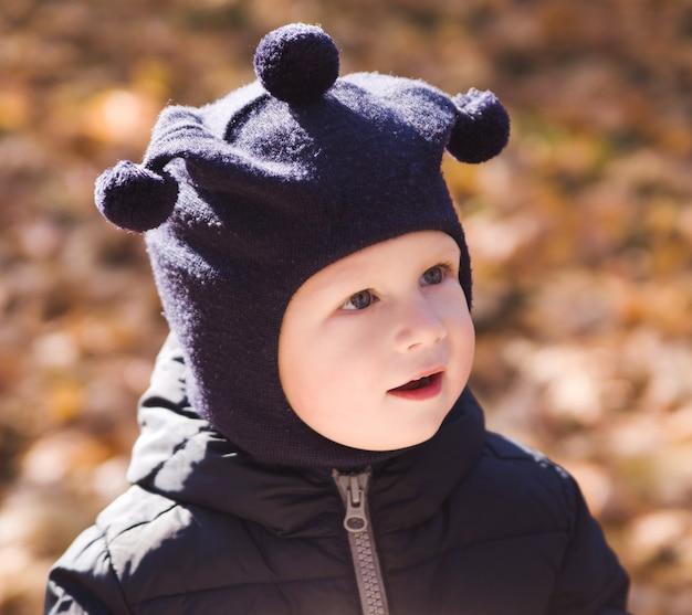 Happy little boy in a park Premium Photo