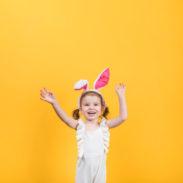 Happy little girl in bunny ears Free Photo