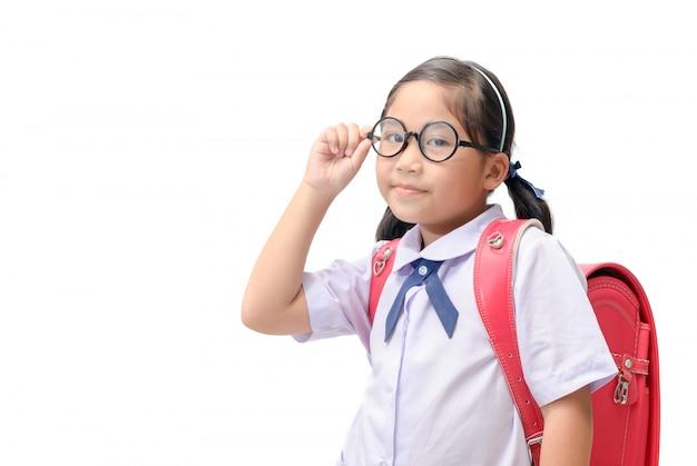 안경을 쓰고 행복 한 작은 여자 학생 프리미엄 사진