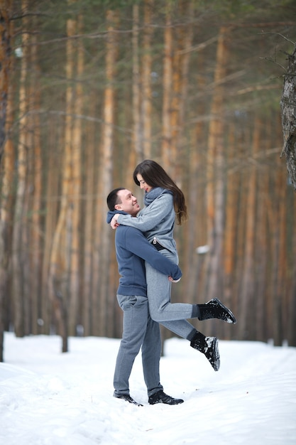 https://image.freepik.com/free-photo/happy-lovers-in-winter-on-background-of-snowy-forest-outdoors_370433-232.jpg