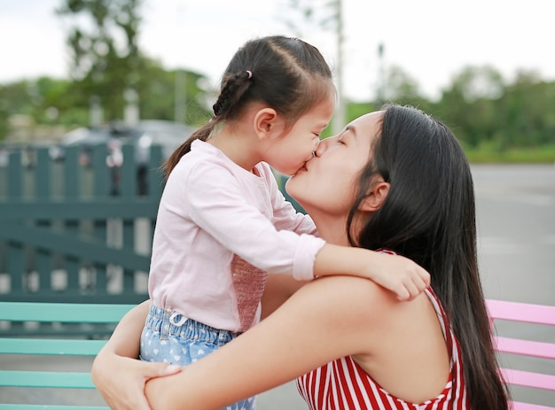 girl-kiss-mother