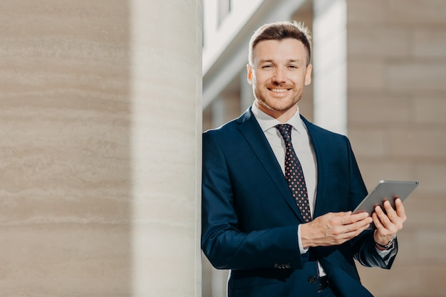 Happy male manager dressed in black formal suit Premium Photo