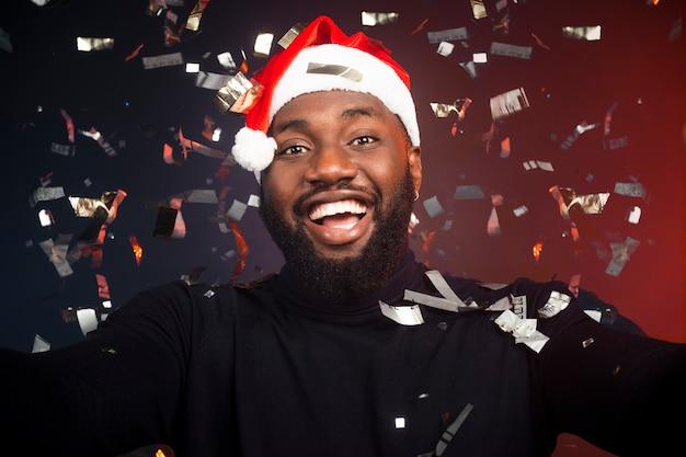 Happy man covered in confetti Free Photo