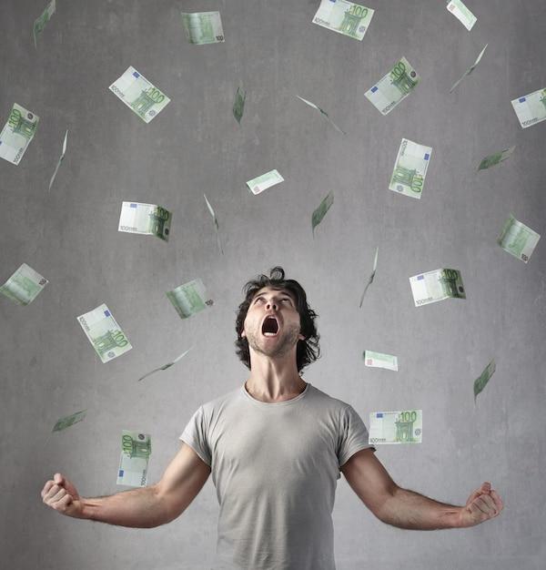 Happy man earning many euros Premium Photo
