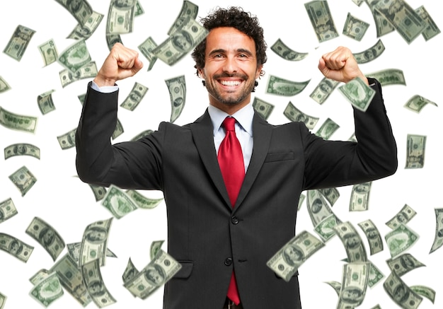 Happy man enjoying the rain of money Premium Photo