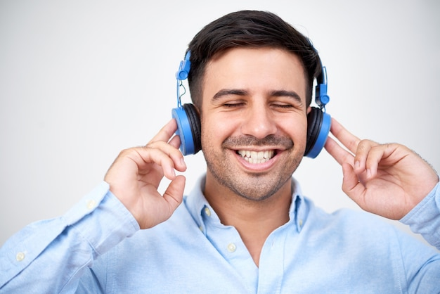 Happy man in headphones Free Photo