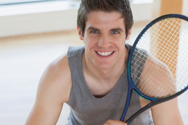 Happy man holding a tennis racket Premium Photo