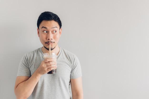 Happy man is drinking bubble milk tea or pearl milk tea Premium Photo