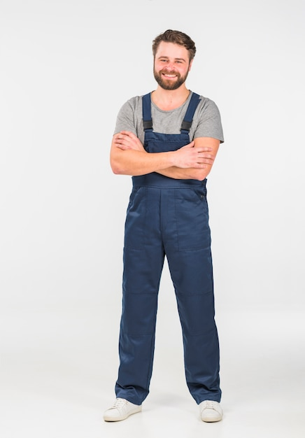 Happy man in overall with crossed arms Free Photo
