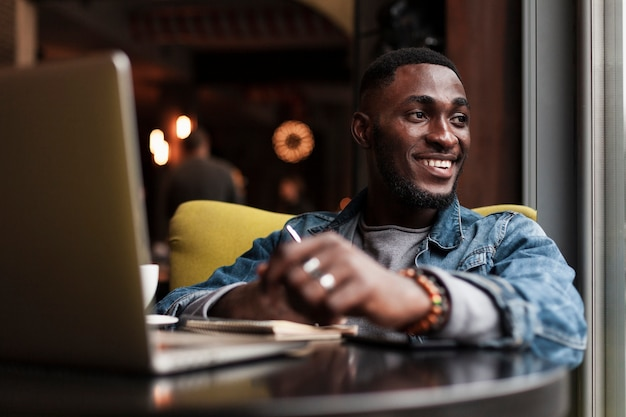Happy man sitting in cafe Free Photo