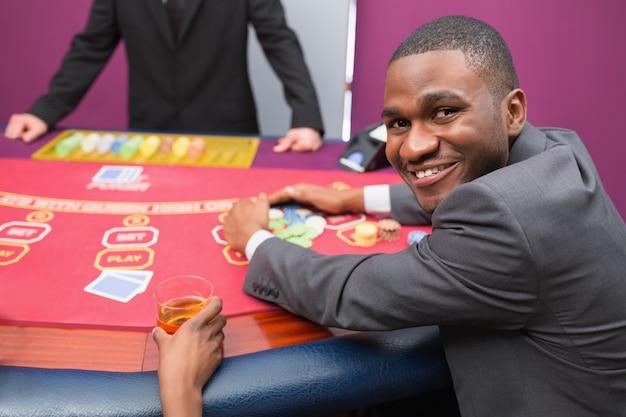 Happy man taking his winnings Premium Photo