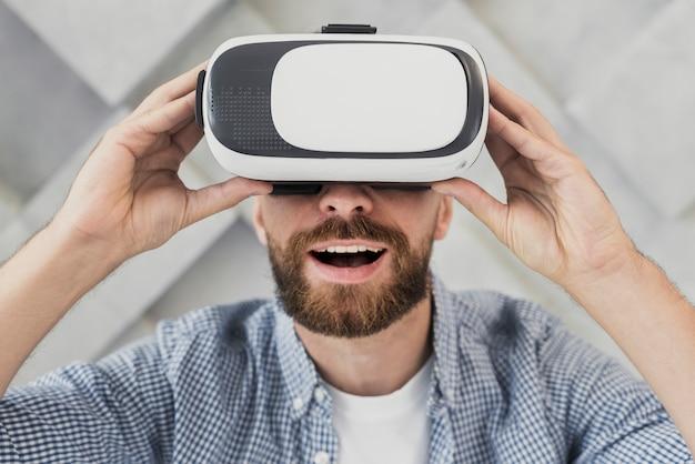 Happy man trying virtual headset Free Photo