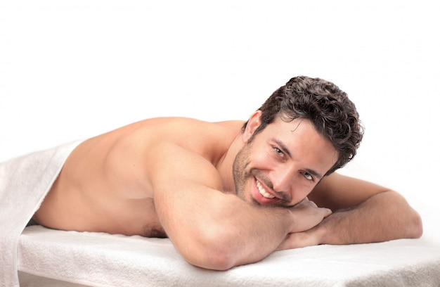 Happy man waiting for a massage Premium Photo
