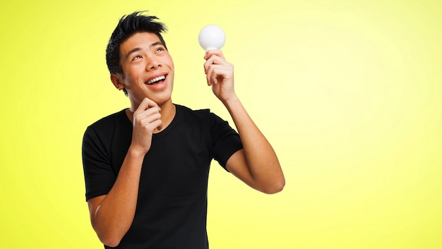Happy man with a light bulb in a hand 1187 1264