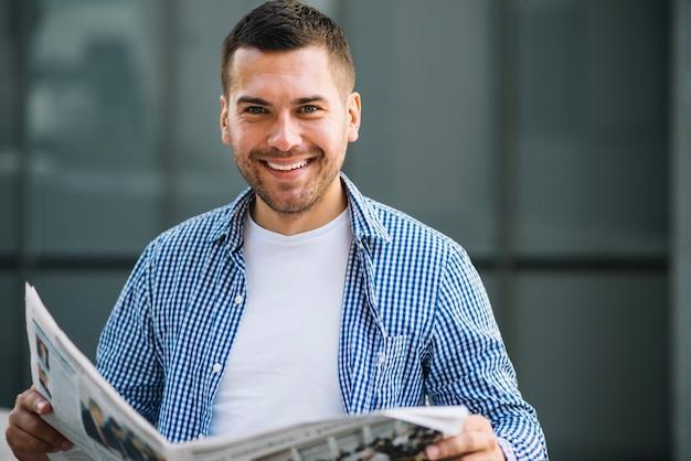 Happy man with newspaper Free Photo