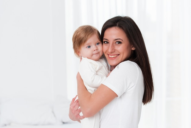 Happy mother and baby posing Free Photo