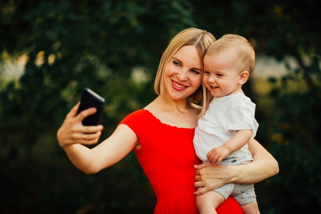 Happy mother and child taking a selfie Free Photo