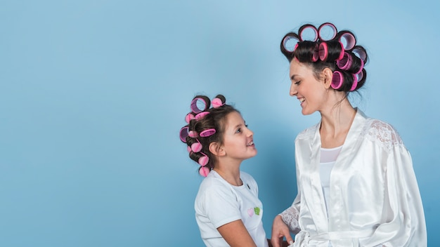 Happy mother and daughter in curlers Free Photo