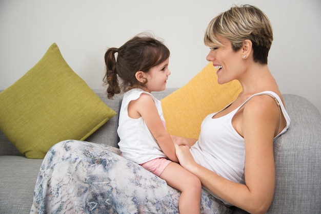 Happy mother enjoying communication with daughter Free Photo