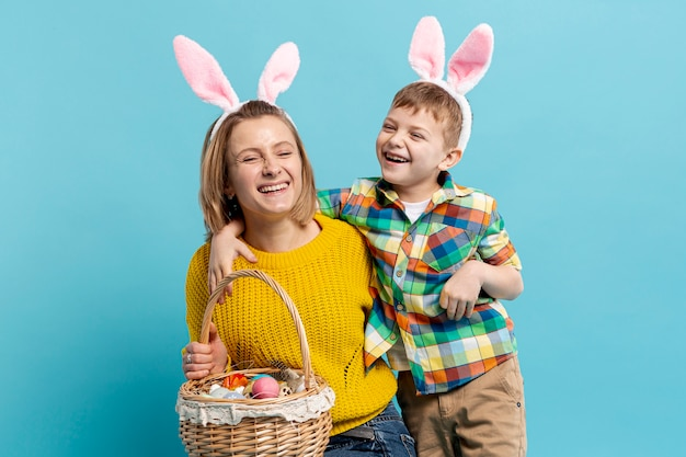 Happy mother and son with basket of painted eggs Free Photo
