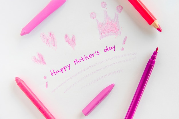 Happy mothers day inscription with drawings and pencils Free Photo