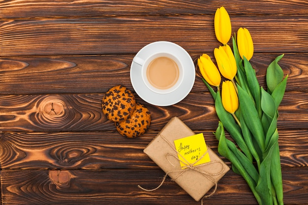 Happy mothers day inscription with tulips and coffee Free Photo