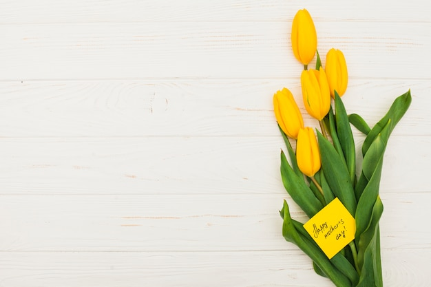 Happy mothers day inscription with tulips Free Photo