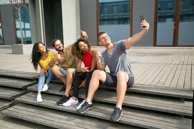 Happy multiethnic students taking selfie Free Photo