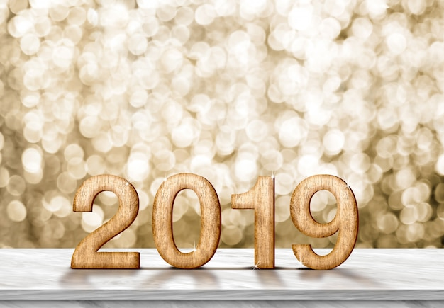 Happy new year 2019 (3d rendering) on grey marble table at gold sparkle bokeh Premium Photo