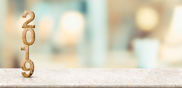 Happy new year 2019 on marble table with soft bokeh wall Premium Photo