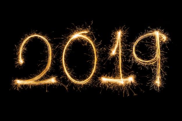 Happy new year 2019 written with sparkle firework | Premium Photo
