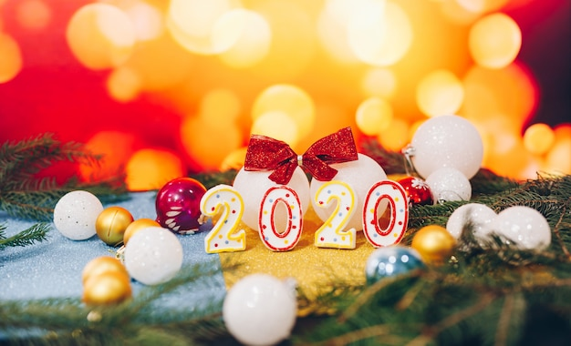 Happy new year 2020 with christmas balls on blur background Premium Photo