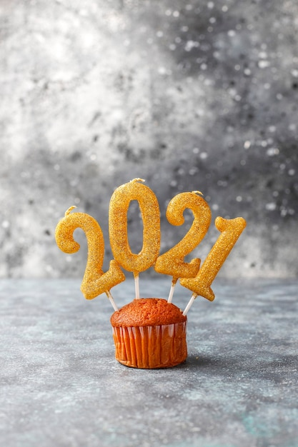 Happy new year 2021,cupcakes with golden candles. Free Photo