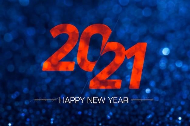 С новым годом 2021 с темно-синим блеском и боке Premium Фотографии