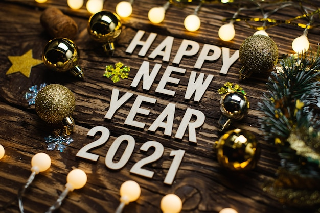 Happy new year 2021 on a wooden table Premium Photo