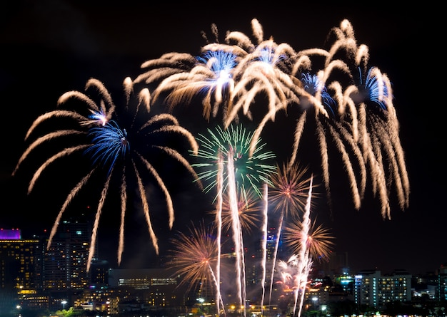 Happy new year fireworks over cityscape at night. holiday celebration festival Premium Photo