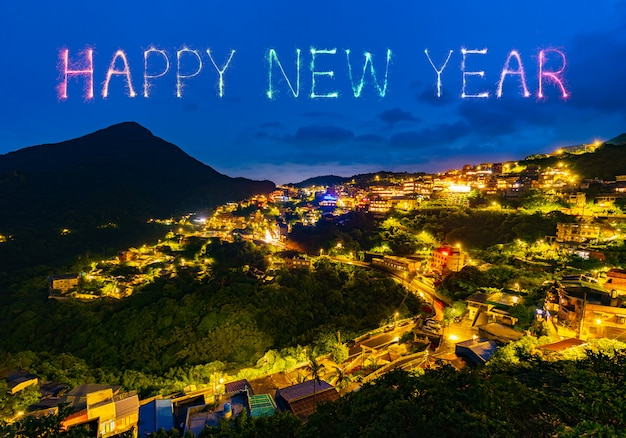Happy new year fireworks over jiufen old street city at night, taiwan Premium Photo
